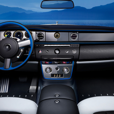 The design also extends to the steering wheel, which features blue accents combined with black leather