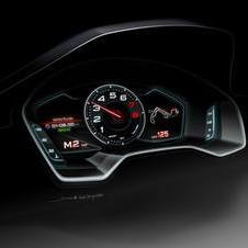 The instrument panel has a central tachometer and two LCD screens