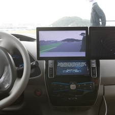 The test cars have monitors to show what the system is doing