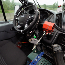 Ford has developed robots to drive test drive its cars at its Michigan proving grounds
