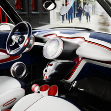 The interior mixes carbon fiber, cloth and leather
