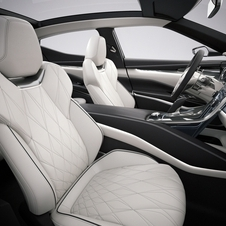 It features a quilted leather interior with contrasting color trim and metal trim