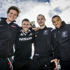 Riep poses with previous winners Lucas Ordonez, Jordan Tresson and Jann Mardenborough