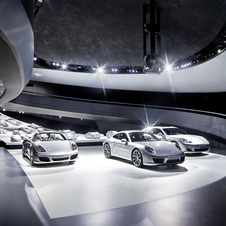 The interior has Porsche models in 1:3 scale and three current, real  cars