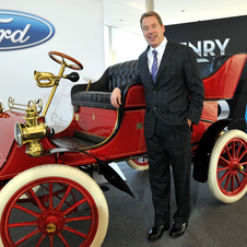 Bill Ford with his great-grandfather's first car sold as Ford Motor Company