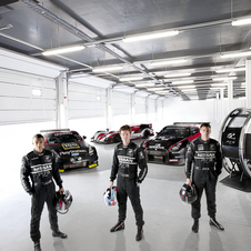 The previous winners posing with the GT Academy vehicles and simulator