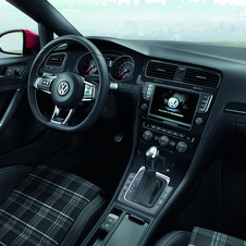The interior is inspired by the GTI with tartan seats and a sport steering wheel