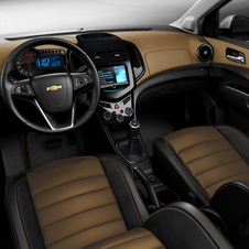 The interior gets a two-tone combination of black and tan with suede.