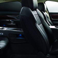 The rear seats are adjustable with a large console that has a beverage cooler and screens in the seats