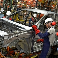 It builds 400,000 cars a year under both brands in India